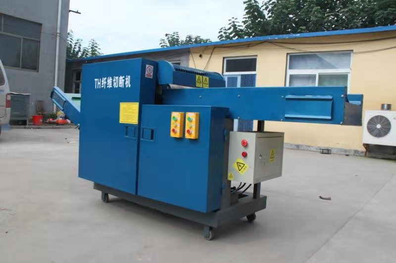 Textile fiber cutting machine